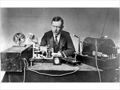 Photo of a man with the Marconi radio