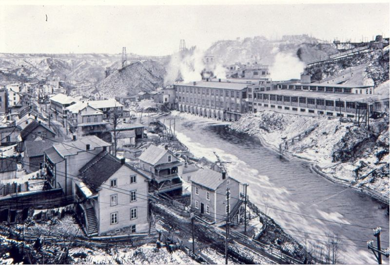 The Belgo pulp and paper mill along the shores of the Shawinigan River. Workers' homes are clearly visible.