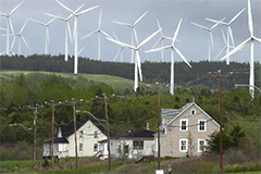 Photo of several wind turbines in action