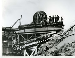 Workers standing on the platform of the funicular of the Shawinigan-2 generating station
