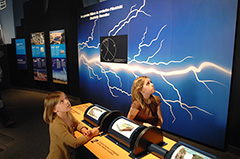 Two young girls exploring The Ages of Energy exhibit