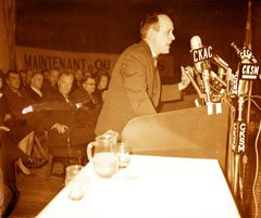 René Lévesque making a speech during an assembly on the nationalization of electricity