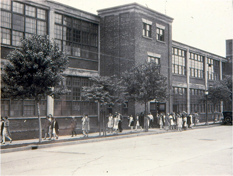 Employees leaving the Wabasso Cotton Company on Rue de la Station